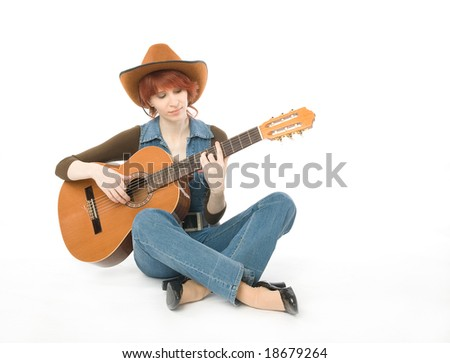 Woman sitting on a floor and playing guitar