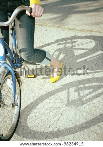 Woman sitting on bicycle