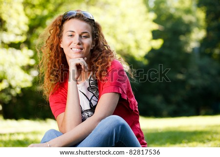 Woman sitting on grass in park