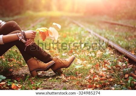 woman sitting on rail trails...