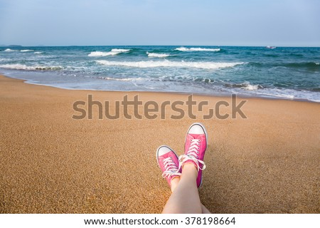 stock photo woman sitting on the beach with first person perspective view legs in focus 378198664 - Каталог - 3d фотообои