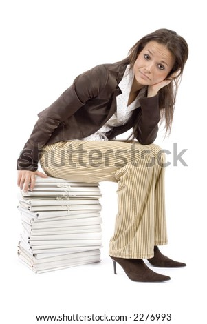 woman sitting on the heap of files (white background)
