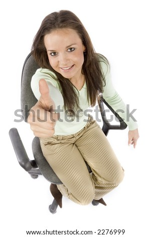 woman sitting on the office chair, showing OK - headshot, white background