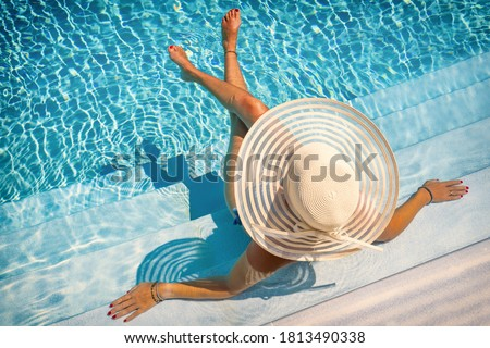 woman sitting on the stairs of a luxury five stars  spa resort  swimming pool.  Stock photo ©