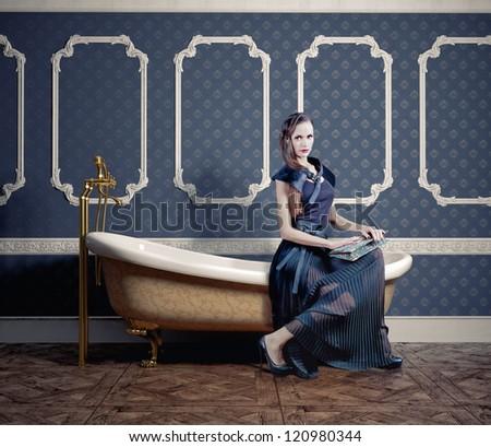 woman , sitting on the vintage bathtub