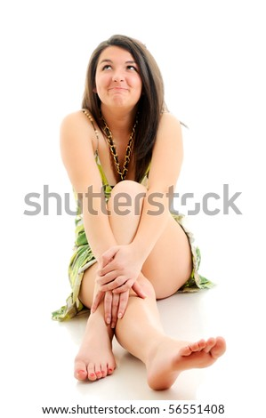 Woman sitting on white floor. Focused on hands.