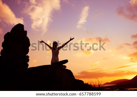 Photo of Woman sitting outdoors feeling happy and free!