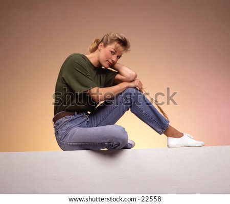 stock photo : Woman Sitting with elbows on knees
