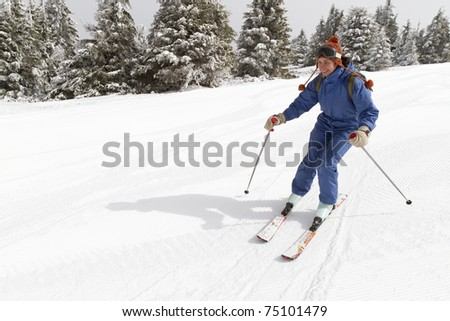 woman skiing on empty ski slope