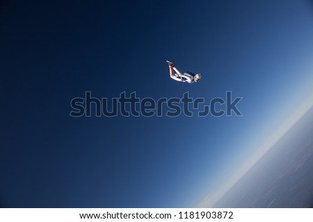 Woman skydiver in the sky
