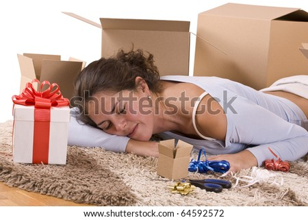 woman sleep on the floor with packages for christmas - stock photo