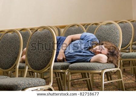 Woman sleeping at boring conference