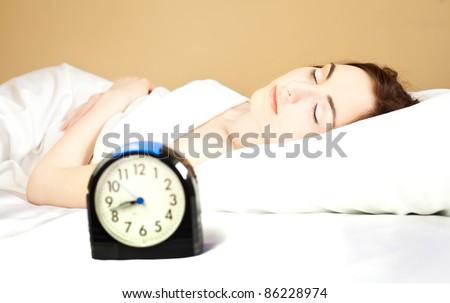 Woman sleeping in bed (focus on woman)