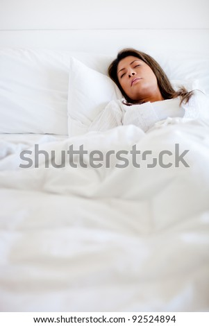 Woman sleeping in bed looking very comfortable