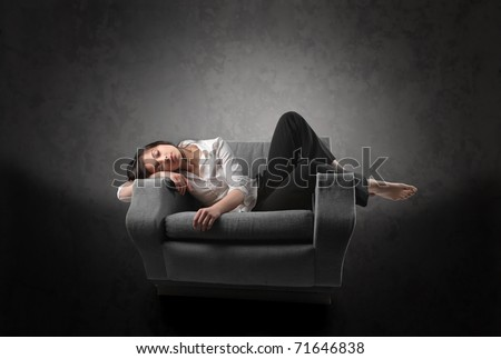 Woman sleeping on an armchair