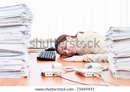 Woman sleeping on working place in office room