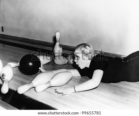 woman sliding down bowling...