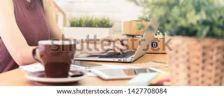 Woman small business owner, business start up conceptual, young entrepreneur work with laptop sell product on line shop, banner wide dimension