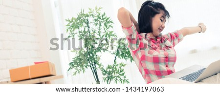 Woman small business owner, business start up conceptual, young entrepreneur work with laptop sell product on line shop stretching in bedroom after hard day work