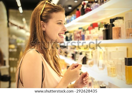 Woman smelling different scents