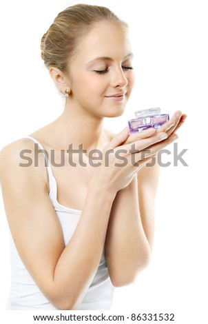 Woman smelling perfume, isolated on white background