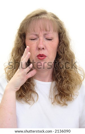 Woman smells something really bad and is grimacing in disgust. Isolated on white.
