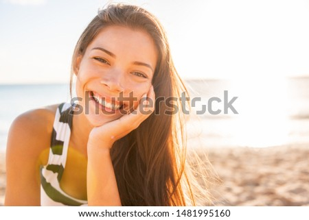 Woman smile happy on beach with healthy glowing skin on sunset sun flare rays summer background. Asian girl smiling confident natural beauty. #1481995160