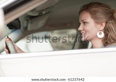 Woman smiling and driving her car