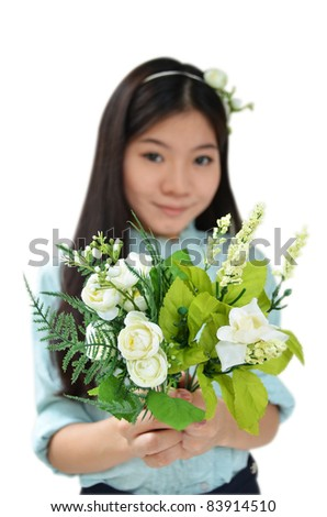 Woman smiling and showing flowers isolated on white background