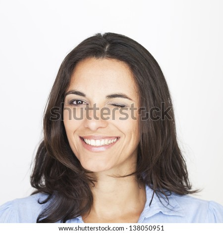 woman smiling and winking