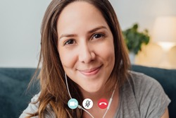 woman smiling during a video call. zoom skype app
