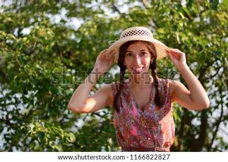 woman smiling holds on to hat nature smile smile happiness travel #1166822827