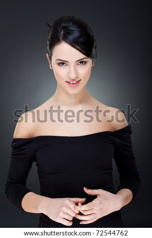 woman smiling in black isolated over a dark background