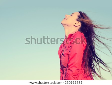 Stock Photo Woman smiling looking up to blue sky taking deep breath celebrating freedom. Positive human emotion face expression feeling life perception success peace mind concept. Free Happy girl enjoying nature