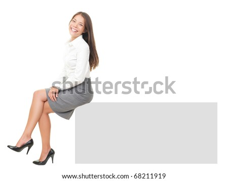 Woman smiling sitting on horizontal banner edge. Happy businesswoman showing sign with lot of copy space. Isolated on white background in full body.