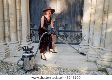 woman smiling while cleaning church stairs with hoover