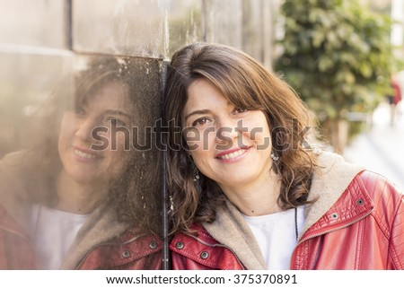 woman smiling while leaning on...