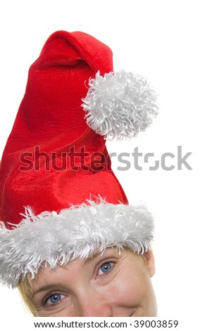 Woman smiling with a santa claus hat on - stock photo