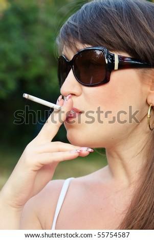 woman smoke a cigarette close up view