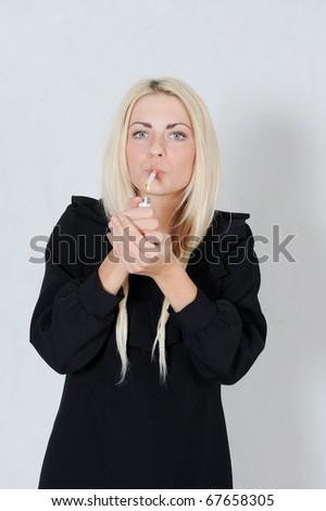 Woman smoking - stock photo