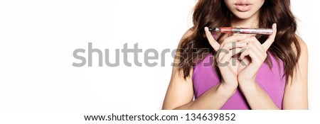 woman smoking e-cigarette wearing purple dress