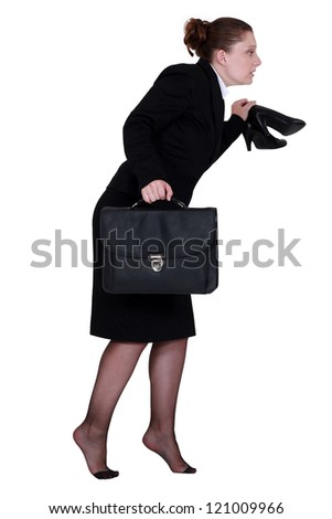 Woman sneaking out of the office