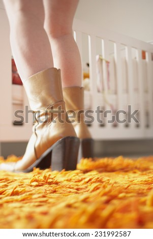 Woman Sneaking up to Crib