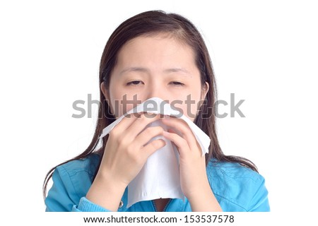 woman sneezing in a tissue, isolated on white background - stock photo