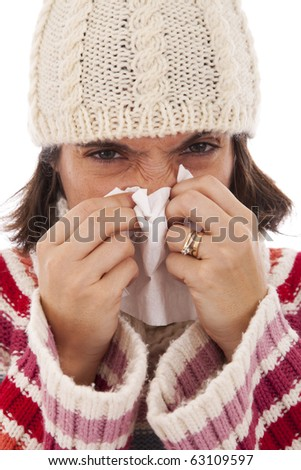 woman sneezing to a paper tissue in winter (isolated on white)