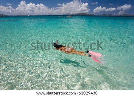 woman snorkeling in tropical water on vacation
