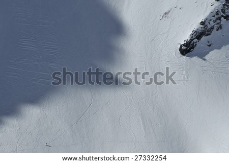 woman snowboarder in the last stage of the 2009 feminine freeride extreme finals. - stock photo