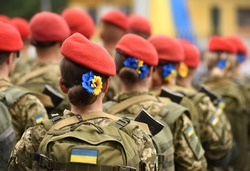 Woman soldier. Woman in army. Ukrainian flag on military uniform. Ukraine troops.