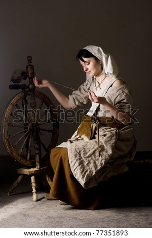Woman spinning on the great or walking wheel