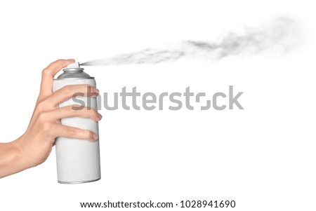 Woman spraying paint from can on white background #1028941690